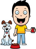 Cartoon Boy Feeding Dog Royalty Free Stock Photos