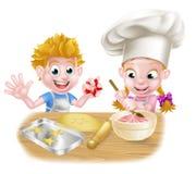 Cartoon Boy and Girl Baking Royalty Free Stock Photo