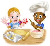 Cartoon Boy and Girl Baking Royalty Free Stock Photography