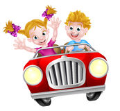 Cartoon Boy and Girl Driving Car Stock Photography