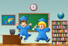 Cartoon boy and girl graduation in a classroom Royalty Free Stock Image