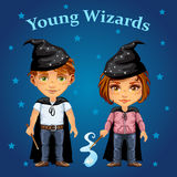 Cartoon boy and girl in wizard costume Stock Photos