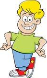 Cartoon boy with hands on hips. Cartoon illustration of a smiling boy with hands on his hips Royalty Free Stock Image