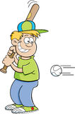Cartoon boy hitting a baseball Royalty Free Stock Photography