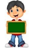 Cartoon boy holding board Stock Photography