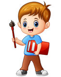 Cartoon boy holding a brush and book stock illustration