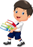 Cartoon boy holding a pile of books Royalty Free Stock Image