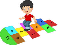 Cartoon boy on the hopscotch Royalty Free Stock Photography
