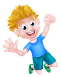 Cartoon Boy Jumping for Joy. A happy cartoon boy jumping for joy and with a fist in the air Stock Image