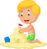 Cartoon boy making sand castle Stock Photo