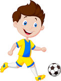 Cartoon boy playing football Royalty Free Stock Image