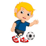 Cartoon boy playing football Royalty Free Stock Image