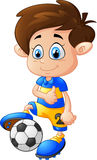 Cartoon boy playing football Royalty Free Stock Photo