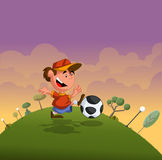 Cartoon boy playing with soccer ball. On green park Stock Photo