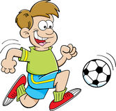 Cartoon boy playing soccer Royalty Free Stock Image