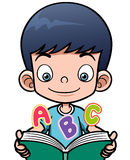 Cartoon boy reading a book Royalty Free Stock Image