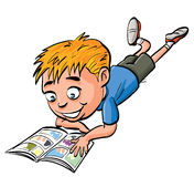 Cartoon boy reading a comic book Royalty Free Stock Photo
