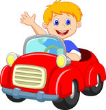 Cartoon boy in the red car Royalty Free Stock Images