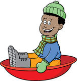 Cartoon boy riding a sled Royalty Free Stock Image