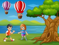 Cartoon a boy running and a floating hot air balloon stock illustration