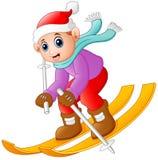 Cartoon boy skiing down Royalty Free Stock Photo