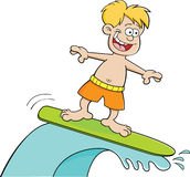 Cartoon boy surfing Stock Photography