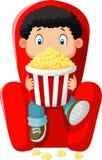 Cartoon boy watching movie in the cinema Royalty Free Stock Image