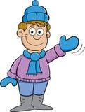 Cartoon boy in Winter clothes waving Royalty Free Stock Photos