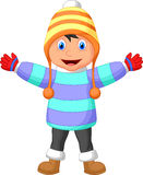 Cartoon a boy in Winter clothes waving hand Royalty Free Stock Photography