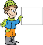 Cartoon boy in Winter clothing holding a sign Royalty Free Stock Photo