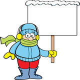 Cartoon boy in Winter clothing holding a sign Royalty Free Stock Photos