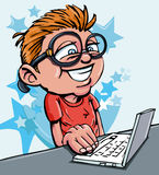 Cartoon of boy working on a laptop Royalty Free Stock Photography