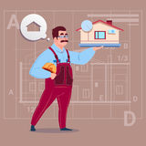 Cartoon Builder Holding Small House Ready Real Estate Over Abstract Plan Background Male Workman Royalty Free Stock Photo
