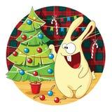 Cartoon bunny decorates Christmas tree Stock Images