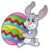 Cartoon Bunny Holding Easter Egg Stock Image