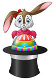Cartoon bunny holding easter eggs in a hat Royalty Free Stock Images