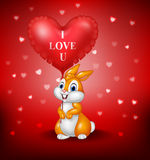 Cartoon bunny holding red heart balloons. Illustration of Cartoon bunny holding red heart balloons Royalty Free Stock Image