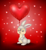 Cartoon bunny holding red heart balloons Stock Images