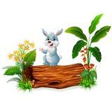 Cartoon bunny on tree trunk Stock Photography