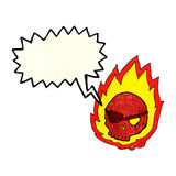 Cartoon burning skull with speech bubble Royalty Free Stock Image