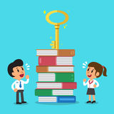 Cartoon business people looking at a key on top of book stack Royalty Free Stock Photography