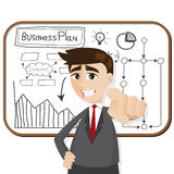 Cartoon businessman with business plan Royalty Free Stock Photo