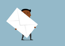 Cartoon businessman carrying a large letter. Cartoon african american businessman carrying a large letter envelope. Business correspondence and delivery concept Royalty Free Stock Photography