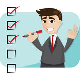 Cartoon businessman with checklist Royalty Free Stock Photo
