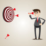Cartoon businessman with dart and target Stock Images