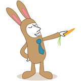 Cartoon businessman dressed up easter bunny pointing Royalty Free Stock Photo