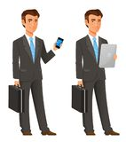 Cartoon businessman in grey suit. Cartoon illustration of a handsome businessman in an elegant dark grey suit holding a mobile phone or tablet Royalty Free Stock Image