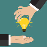 Cartoon businessman hand holding idea light bulb Royalty Free Stock Images