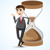 Cartoon businessman with hourglass. Illustration of cartoon businessman with hourglass Royalty Free Stock Image