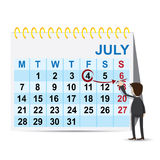 Cartoon businessman marking weekend on calendar Royalty Free Stock Image